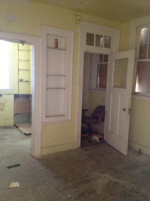 This is the kitchen. That back area you see behind the built ins has to be torn off. It was a tiny kitchen.