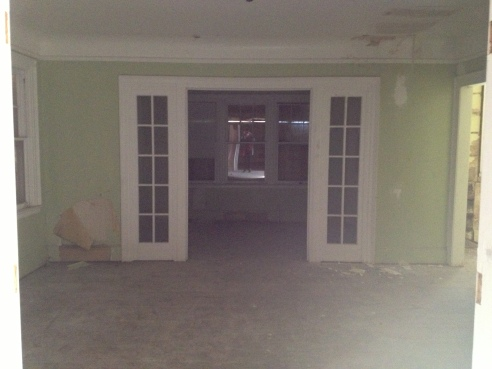 The dining room. Though those french doors lead to the porch/sunroom that has to be torn off.